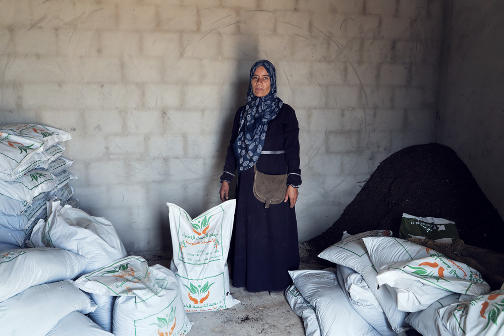 Thouraya stands for a portrait inside the stock room. ©IFAD/Alfredo D'Amato/Panos